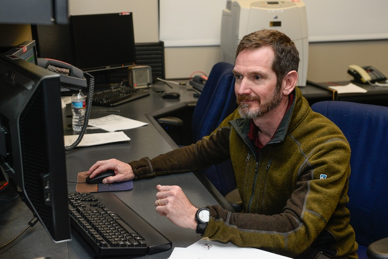 Joseph Carberry, Boeing lead satellite bus engineer, sends the final commands to SVN-40, nicknamed dough boy, to cease transmission operations Friday, March 11, 2016, at Schriever Air Force Base, Colorado. The 2nd Space Operations Squadron spent a week moving the satellite outside operational orbit where it will now remain and continue to be tracked.  SVN-40 was originally launched in 1996 with an expected use time of seven and a half years.  Nearly 20 years later, the satellite was removed from service due to an attitude control failure.  Carberry was the lead engineer when SVN-40 was initially launched.  (U.S. Air Force photo/Christopher DeWitt)