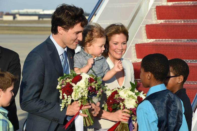 Canadian Prime Minister Justin Trudeau and first lady Sophie Gregoire-Trudeau are greeted with flowers by Jalique Wiseman and Aniya Walker, WB Patterson Elementary School students, at Joint Base Andrews, Md., March 11, 2016. Trudeau arrives for his first U.S. state visit as the Prime Minister of Canada. (U.S. Air Force photo by Senior Airman Joshua R. M. Dewberry/RELEASED)