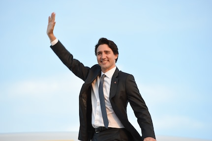 Canadian Prime Minister Justin Trudeau waves goodbye as he boards his plane at Joint Base Andrews, Md., March 11, 2016. Trudeau leaves after completing a three-day state visit with U.S. President Barack Obama to strengthen U.S.-Canada relations. (U.S. Air Force photo by Senior Airman Joshua R. M. Dewberry/RELEASED)
