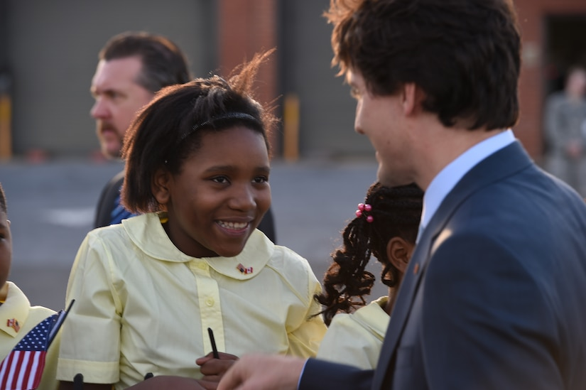 Canadian Prime Minister Justin Trudeau is greeted by District of Columbia school children at Joint Base Andrews, Md., March 11, 2016. Trudeau arrives in the U.S. for a three-day state visit with President Barack Obama to strengthen U.S.-Canadian relations. (U.S. Air Force photo by Senior Airman Joshua R. M. Dewberry/RELEASED)