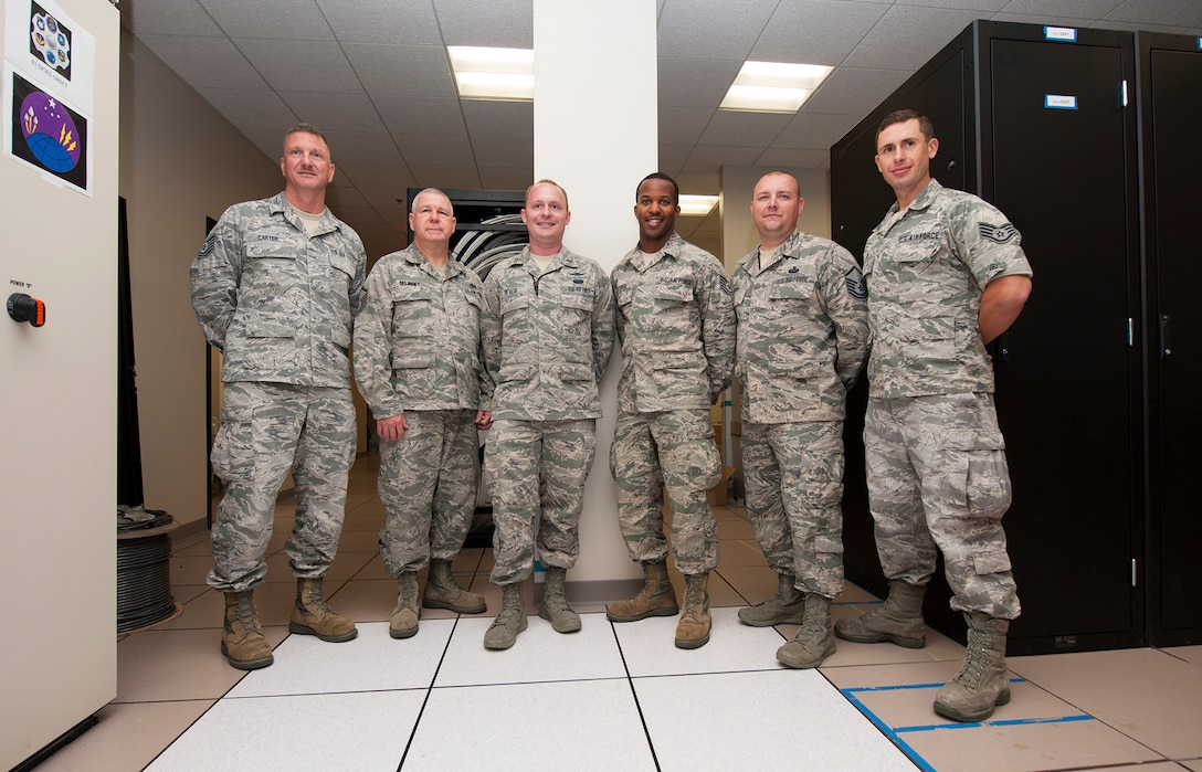 The Air National Guard Engineering Installation team at Vandenberg is headed up by Tech. Sgt. Brian Carter, 130th EIS, Communication Team Lead; Master Sgt. Michael Selinsky, 270th EIS, Range Simulation Center Team Lead; 1st Lt. Vincente De Vita, 130th EIS, ANG OIC; Tech. Sgt Aamir Cooper, 270th EIS, Telemetry Analog Equipment Room Team Lead; Master Sgt. Kyle Wood, 130th EIS, ANG NCOIC/Team Chief; and Staff Sgt. Chris Cox, 217th EIS, Range Data Control Center Team Lead. (U.S. Air Force photo by Michael Peterson/released)