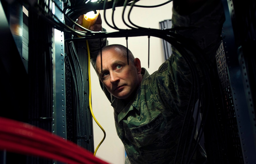 Tech. Sgt. Jeremy Nagy, 270th Engineering Installation Squadron, Range Simulation Center Installer, inspects a cabinet of recently installed cables March 2, 2016, Vandenberg Air Force Base, Calif. Nagy is part of an Air National Guard EI team working on a relocation of the Launch and Test Range System for the Western Range. (U.S. Air Force photo by Michael Peterson/released)