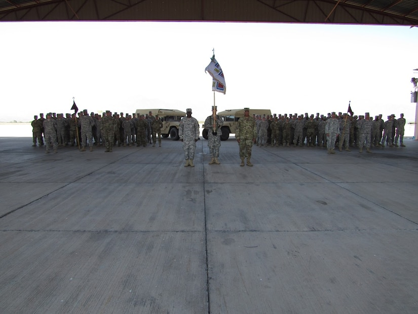 Soldiers from the 325th and 94th Combat Support Hospitals stand in formation during a change of responsibility ceremony for the Joint Task Force-Bravo Medical Element March 8, 2016 at Soto Cano Air Base, Honduras. The 325th, from Independence, Missouri, deployed to Honduras on February 2016, replacing the outbound personnel from the 94th, whose home station is located in Seagoville, Texas (U.S. Army photo illustration by Capt. Faith Coffey/Released)