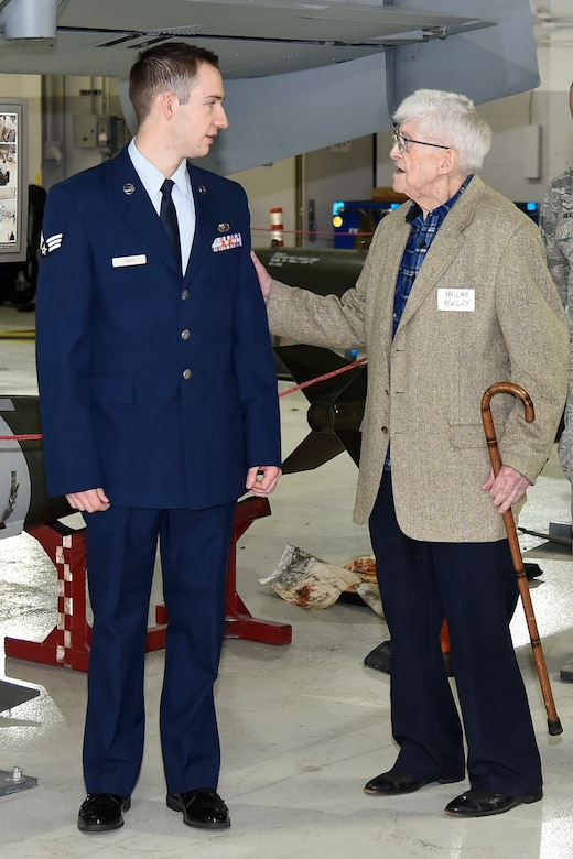 Philas Kelly, at age 102 likely the oldest living former photographer to have served in the National Guard, talks with Senior Airman Ryan Zeski, the youngest photojournalist currently serving in the Michigan Air National Guard's 127th Wing at Selfridge Air National Guard Base. Kelly was recently a guest at the base to visit his old unit, now the 107th Fighter Squadron. (U.S. Air National Guard photo by Terry Atwell)