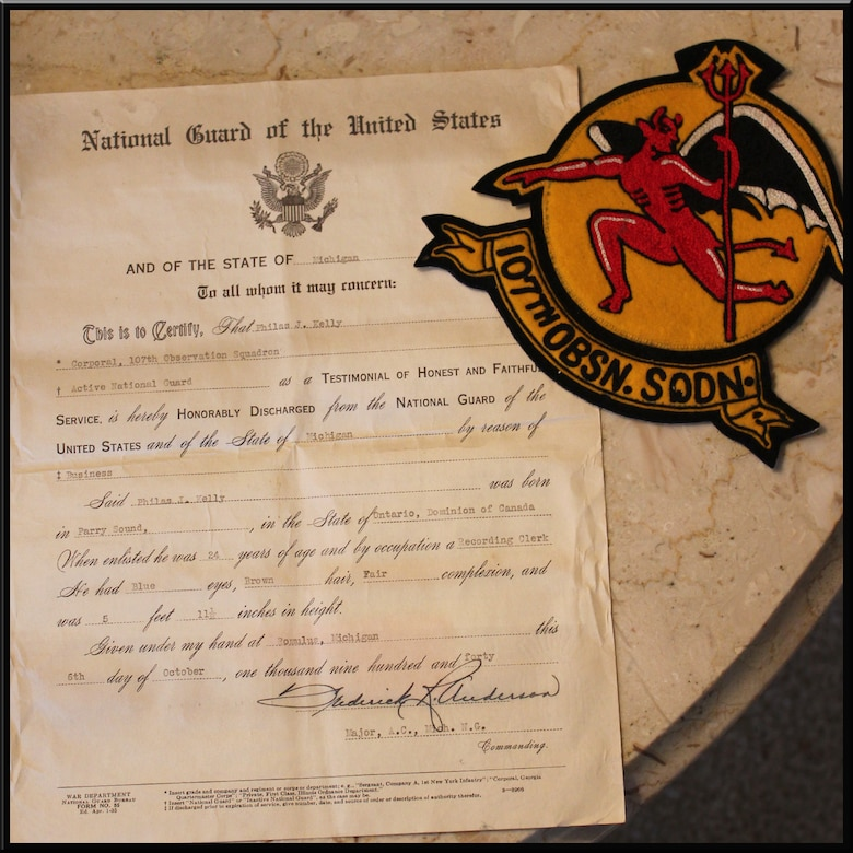 The discharge certificate and former squadron patch of Philas Kelly is seen in this Feb. 2, 2016 photo. Kelly, age 102, served in the 107th Observation Squadron, which is now the 107th Fighter Squadron, in the Michigan Air National Guard prior to World War II. (U.S. Air National Guard photo by Staff Sgt. Samara Taylor)