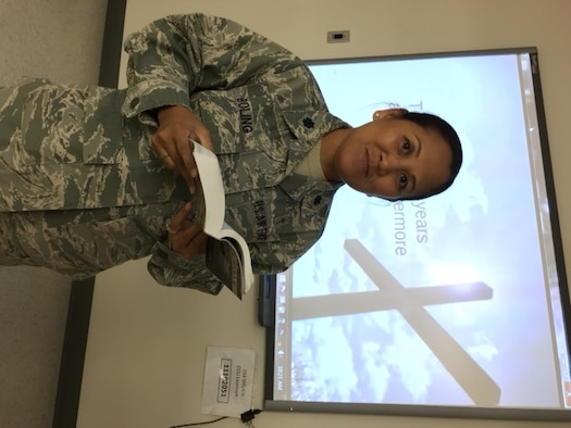 U.S. Air Force Lt. Col. Leah Boling, 154th Wing Chaplain, prepares to read scripture to Airmen during a religious service. Chaplain Boling is the 154th Wing's first and only female chaplain. (courtesy photo)