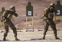 Marines with Marine Wing Support Squadron 371, based out of Marine Corps Air Station Yuma, perform shooting drills with their M16A4 service rifles during a squadron field exercise at the U.S. Army Yuma Proving Ground training facility in Yuma, Ariz., Wednesday, March 9, 2016.