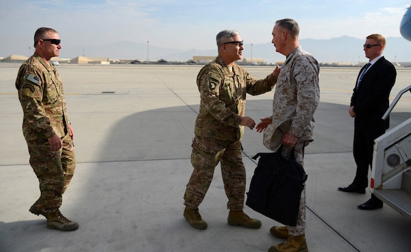 Army Gen. John F. Campbell, center left, then-commander of NATO's Resolute Support mission and U.S. forces in Afghanistan, welcomes Marine Corps Gen. Joseph F. Dunford Jr., chairman of the Joint Chiefs of Staff, to Bagram Airfield, Afghanistan, Dec. 8, 2015. (DoD photo by Air Force Staff Sgt. Tony Coronado)