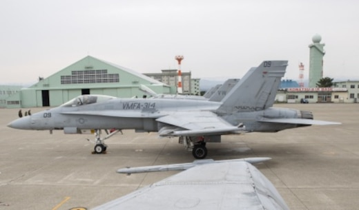 """FA-18A++ Hornets with Marine Fighter Attack Squadron(VMFA) 314, forward based at Marine Corps Air Station Iwakuni, Japan, are lined up on the flightline at Komatsu Air Base, Japan, during the Komatsu Aviation Training Relocation exercise March 7-18, 2016. VMFA-314, also known as the """"Black Knights,"""" took the lead in conducting dissimilar air combat training and bilateral tactical mission training with the Japan Air Self-Defense Force. Not only does this training mission increase the squadron's readiness in air-to-air mission sets and executes flight leadership qualification upgrades, it supports theater security cooperation and combined interoperability with the JASDF. (U.S. Marine Corps photo by Cpl. Nicole Zurbrugg/Released)"""