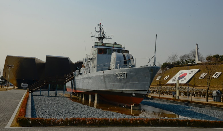 Republic of Korea Navy Patrol Killer Medium 357 from the second Yeonpyeong Sea Battle is shown outside of the West Sea Protection Hall at the ROK Navy 2nd Fleet Command in Pyeongtaek-si, Gyeonggi-do Province on Feb. 26, 2016. The sea battles took place June 15, 1999, and June 29, 2002, and are two of recent attacks on South Korea from North Korea patrols. (U.S. Air Force photo by Senior Airman Kristin High/Released)