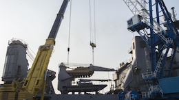 A M1A1 Abram tank attached to Delta Company 1st Tank Battalion, 1st U.S. Marine Division is lifted by two pier side cranes onto amphibious dock landing ship USS Ashland (LSD 48) at Gwangyang, South Korea to prepare for the Assault Follow-On Echelon portion of Exercise Ssang Yong 2016 March 14, 2016. Ashland is assigned to the Bonhomme Richard Expeditionary Strike Group and is participating in SY16, a biennial combined amphibious exercise conducted by forward-deployed U.S. forces with the Republic of Korea Navy and Marine Corps, Australian Army and Royal New Zealand Army Forces in order to strengthen our interoperability and working relationships across a wide range of military operations-from disaster relief to complex expeditionary operations.