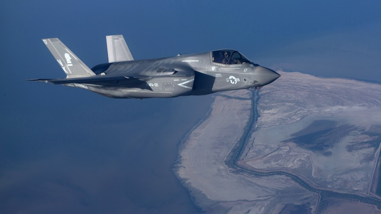 """An F-35B Lightning II with Marine Fighter Attack Squadron 121 """"Green Knights"""" flies alongside a KC-130J Super Hercules with Marine Aerial Refueler Transport Squadron 352 over Southern California, March 8, 2016. The two F-35Bs completed additional training after successfully conducting an aerial refuel with VMGR-352."""