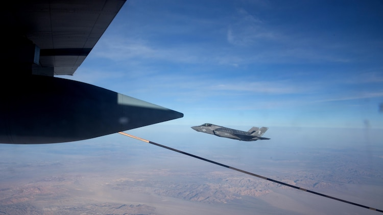 """An F-35B Lightning II with Marine Fighter Attack Squadron 121 """"Green Knights"""" flies alongside a KC-130J Super Hercules with Marine Aerial Refueler Transport Squadron 352 over Southern California, March 8, 2016. An aerial refuel, also called air-to-air refuel, allows the F-35B to perform close air support missions for a longer period of time."""