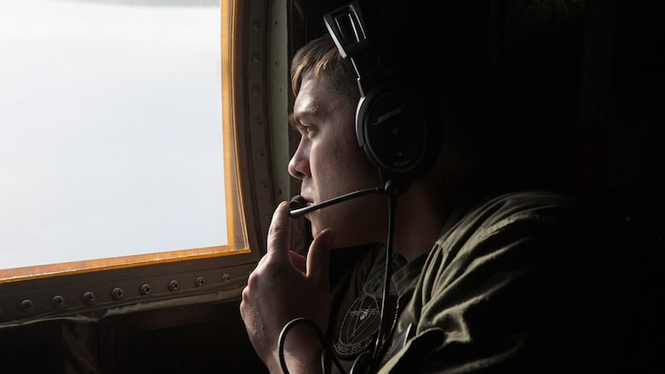 Cpl. Cody Holder, a crew master with Marine Aerial Refueler Transport Squadron 352 and an Easton, Pa. native, observes an F-35B Lightning II during an aerial refueling mission over Southern California, March 8, 2016. Marines with VMGR-352 supported an aerial refueling mission with two F-35Bs from Marine Fighter Attack Squadron 121.