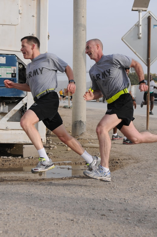U.S. Army Lt. Gen. Jeffrey Talley, left, the chief of the Army Reserve, and Command Sgt. Maj. James Lambert, his senior enlisted advisor, race to the finish line of a 5K run to mark the component's 105th anniversary at Kandahar Airfield in Kandahar province, Afghanistan, April 27, 2013. (U.S. Army photo by Sgt. Phillip Valentine/Released)