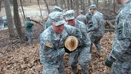 Army Reserve Soldiers from 1st Battalion, 383rd Training Support Battalion, 166th Aviation Brigade, First Army Division West – based at Fort Des Moines- work together with the City of Des Moines Parks and Recreation Department to remove logs and brush from Greenwood Park in Des Moines, Iowa, on April 5. This was the first step in allowing the park to return to a more natural state after a rough winter there. Following the cleanup project, the soldiers returned to their reserve center where they hosted their 106th birthday celebration of the Army Reserve with Mayor Pro Tem T.H. Bob Mahaffey, 14-year Air Force Reserve veteran. (Photo by Capt. Mark Butcher)