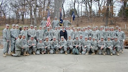 Army Reserve soldiers assigned to 1st Battalion, 383rd Training Support Battalion, 166th Aviation Brigade, First Army Division West – based at Fort Des Moines, pause for a photo during a project with the City of Des Moines Parks and Recreation Department, to help restore the Greenwood Park in Des Moines, Iowa, April 5. (Photo by Capt. Mark Butcher)