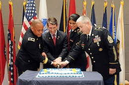 From left to right, Brig. Gen. Gracus K. Dunn, commanding general, 85th Support Command and seputy commanding general for support, First Army Division-West; Mayor Thomas Hayes, mayor of Arlington Heights, Ill., and former West Point U.S Military Academy graduate; Pfc. Yvette Leon, Human Resources specialist, and the command's most junior soldier; and Command Sgt. Maj. Kevin Greene, command sergeant major, 85th Support Command and senior enlisted soldier cut a cake during the 106th birthday celebration of the Army Reserve at the unit's headquarters near Chicago on April 5. (U.S. Army photo by Sgt. 1st Class Anthony L. Taylor/Released)