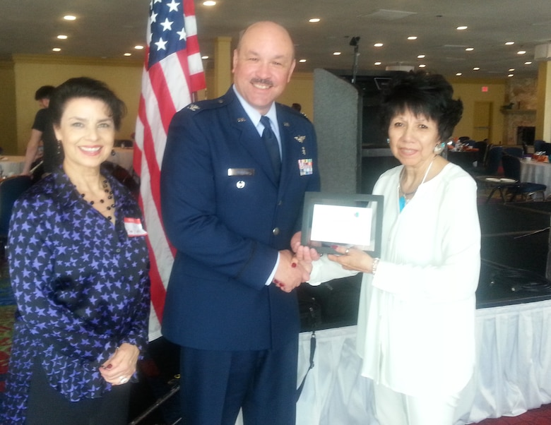 Col. W. Javier Nieves, the 10th Medical Group's chief of aerospace medicine at the U.S. Air Force Academy, receives a certificate of appreciation from Anna Marie Ortiz (left) and Carmen Abeyta, March 9, 2016. Ortiz and Abeyta organized the Latino Community Luncheon in Colorado Springs that day, which featured Neives as guest speaker. (U.S. Air Force photo/Melissa Porter)