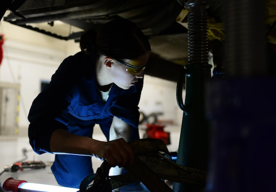 U.S. Air Force Staff Sgt. Vanessa Hoppough, a 354th Logistics Readiness Squadron special vehicle maintenance journeyman, works under a fuel truck March 2, 2016, at Eielson Air Force Base, Alaska. Hoppough and a team of Airmen worked to replace seals and O-rings on the transmission and return it to its service. (U.S. Air Force photo by Airman 1st Class Cassandra Whitman/Released)