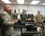 Jose Terrones from U.S. Army South translates maintenance procedures into Spanish during a Subject Matter Expert Exchange at the Combined Support Maintenance Shop at McEntire Joint National Guard Base, Eastover, South Carolina, March 8, 2016. Maintenance officers from the Colombian army toured South Carolina Army National Guard maintenance facilities during a State Partnership Program Subject Matter Expert Exchange held March 7-11, 2016.