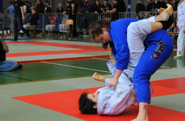 Mariah Johnson, a 52nd Force Support Squadron value-added tax officer who practices Brazilian jiujitsu, right, grapples during her first match at the Submissao competition in Karlsruhe, Germany, Feb. 20, 2016. Johnson lost to her opponent, but received a belt promotion after the match for taking the step to compete. (Courtesy photo)