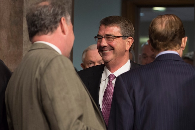 Defense Secretary Ash Carter shares a light moment before he testifies on the Defense Department's proposed fiscal year 2017 budget during a posture hearing before the Senate Armed Services Committee in Washington, D.C., March 17, 2016. DoD photo by Air Force Senior Master Sgt. Adrian Cadiz