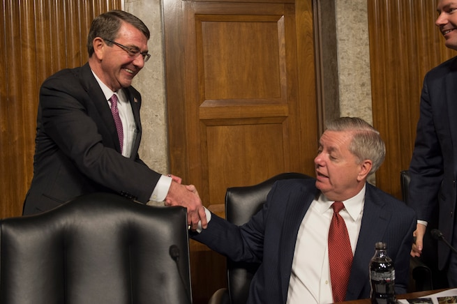 Defense Secretary Ash Carter, left, shakes hands with U.S. Sen. Lindsey Graham of South Carolina before a Senate Armed Services Committee hearing in Washington, D.C., March 17, 2016. DoD photo by Air Force Senior Master Sgt. Adrian Cadiz