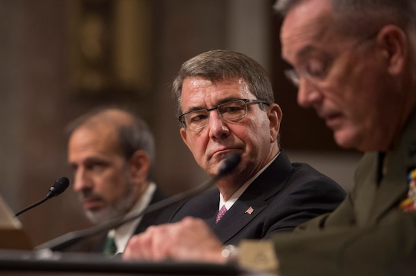 Defense Secretary Ash Carter listens as Marine Corps Gen. Joseph Dunford, chairman of the Joint Chiefs of Staff, testifies on the Defense Department's proposed fiscal year 2017 budget before the Senate Armed Services Committee in Washington, D.C., March 17, 2016. DoD photo by Senior Master Sgt. Adrian Cadiz