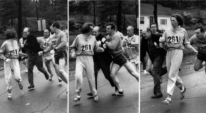 A race official tries to stop Katherine Switzer from participating in the 1967 Boston Marathon. (Courtesy Photo)
