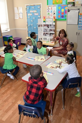 Martha Cook, HNC executive officer, speaks to Ms. Maze's pre-kindergarten students about their project during the First Baptist Child Development Center & Academy science fair.
