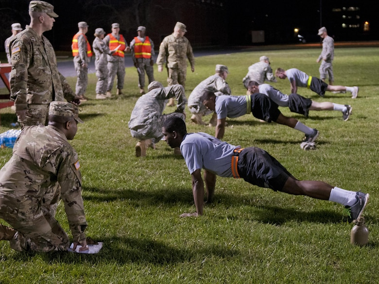 U.S. Army Reserve Soldiers, competing in the 316th Sustainment Command (Expeditionary) Best Warrior Competition, performs pushups during the Army Physical Fitness Test at Fort Knox, Ky., March 16, 2016. (U.S. Army photo by Staff Sgt. Dalton Smith/Released)