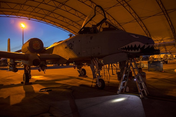 An A-10C Thunderbolt II rests under an awning while U.S. Air Force Airmen from the 74th Aircraft Maintenance Unit perform repairs, March 10, 2016, at Moody Air Force Base, Ga. A-10's are primarily used for close air support due to their weapons-delivery systems and their ability to maneuver at low air speeds and altitude. (U.S. Air Force photo by Airman 1st Class Lauren M. Johnson/Released)