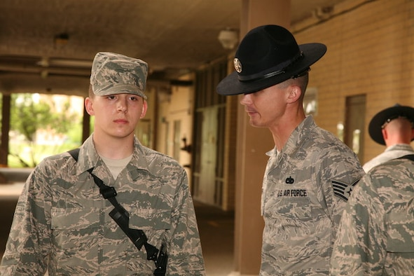 Then-Staff Sgt. Joshua Smith, a 326th Training Squadron military training instructor, speaks to a trainee going through basic training at Joint Base San Antonio-Lackland, Texas, in April 2010. Smith served as an MTI for four years before moving to McConnell Air Force Base, Kan., and eventually becoming an Airman leadership school instructor. (Courtesy photo)