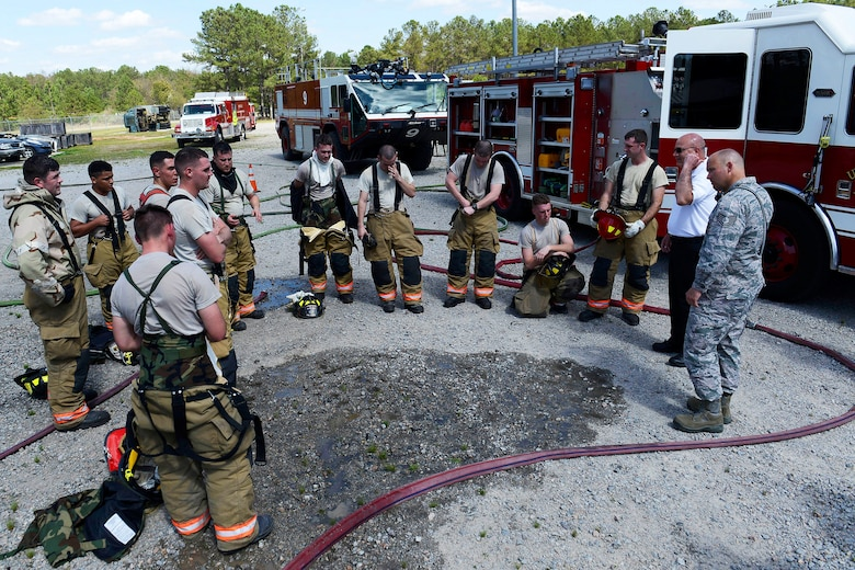 U.S. Airmen assigned to the 20th Civil Engineer Squadron fire department participate in a hot wash on their training procedures at Shaw Air Force Base, S.C., March 14, 2016. Airmen assigned to the 20th CES fire department are given extensive training and procedures that must be executed effectively with minimal errors. (U.S. Air Force photo by Airman 1st Class Christopher Maldonado)