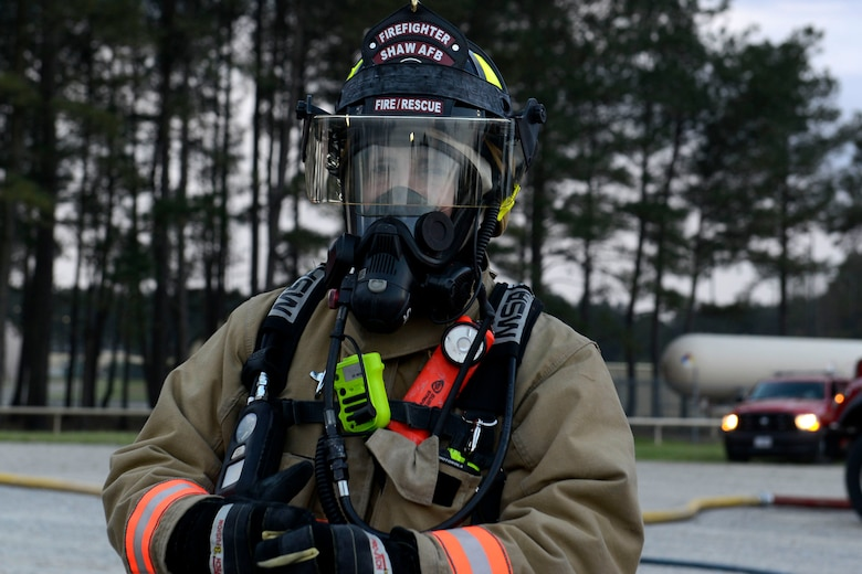 U.S. Air Force Senior Airman Nathan Webber, 20th Civil Engineer Squadron firefighter, waits for the conclusion of aircraft fire training at Shaw Air Force Base, S.C., March 17, 2016. Webber and other firefighters from the 20th CES fire department communicated and worked together to extinguish a fire on a mock C-130. (U.S. Air Force photo by Airman 1st Class Christopher Maldonado)