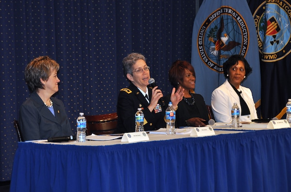 Army Maj. Gen. Julie Bentz, vice director, Joint Improvised-Threat Defeat Agency, answers a question. Other panelists (from left): Shari Durand, executive director, Defense Threat Reduction Agency; Clothilda Taylor, principal deputy director, administration, Office of the Under Secretary of Defense; and retired Air Force Chief Master Sgt. Helen Noel.