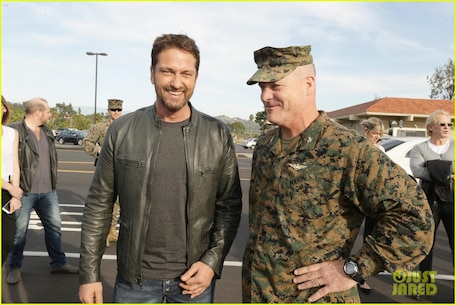 """Hollywood star Gerard Butler visited Camp Pendleton, where he screened his new movie, """"London Has Fallen,"""" in with military and their families. Butler, escorted by Col. Ian R. Clark and Lt. Col. David Fairleigh, said the troops have always been big supporters of his movies, and this visit was about honoring our real-life heroes ."""