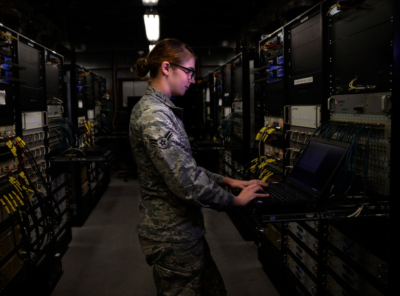 Airman 1st Class Ashley, 432nd Aircraft Communications Maintenance Squadron radio frequencies transmission technician checks a control monitor and alarm computer for discrepancies  Aug. 19, 2015, at Creech Air Force Base, Nevada. The ACMS is responsible for maintaining all communications equipment needed to fly a remotely piloted aircraft. (U.S. Air Force photo by Airman 1st Class Christian Clausen/Released)