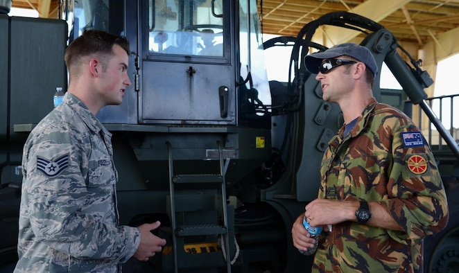 U.S. Air Force Staff Sgt. Joshua Foley, 36th Mobility Response Squadron aerial port supervisor, and Royal New Zealand Air Force Squadron Leader Brandon Purdue, operations squadron representative, discuss operational capabilities during Pacific Agility 16-1 March 15 , 2016, at Andersen Air Force Base, Guam. Pacific Agility is a Pacific Air Forces-led engagement focusing on a series of logistics subject-matter expert exchanges designed to increase partner capabilities, military relations and regional stability for the Indo-Asia-Pacific region. (U.S. Air Force photo by Airman 1st Class Arielle Vasquez/Released)