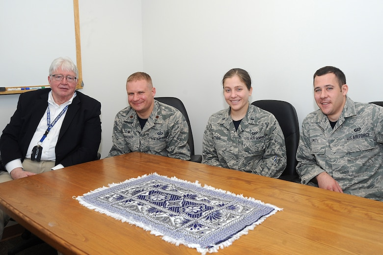 The McConnell business mentoring team poses for a photo during a lunch committee meeting, March 11, 2016, at McConnell Air Force Base, Kan. The volunteer team provides strategic business mentoring to women-owned businesses in Rwanda and Afghanistan. (U.S. Air Force photo/Airman Jenna K. Caldwell)