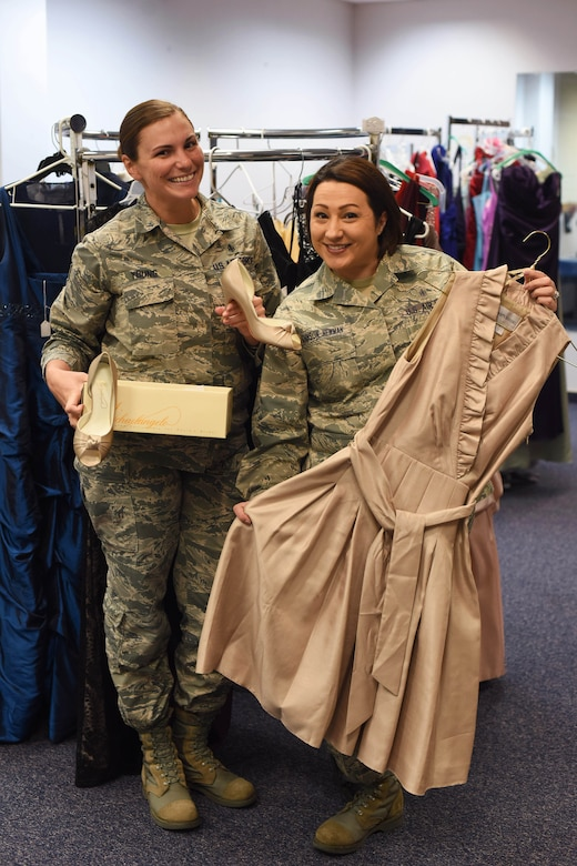 Staff Sgt. Sheena Young, 341st Missile Wing command chief executive, left, and Tech. Sgt. Jenny Johnson-Newman, 341st Medical Operations Squadron NCO in charge of health management, pose for a photograph at the Cinderella's Closet shop March 15, 2016 at Malmstrom Air Force Base, Mont. The closet's initiative is to help military members and dependents save money while having easy access to women's dresses and gowns for formal and non-formal events. (U.S. Air Force photo/Airman Collin Schmidt)