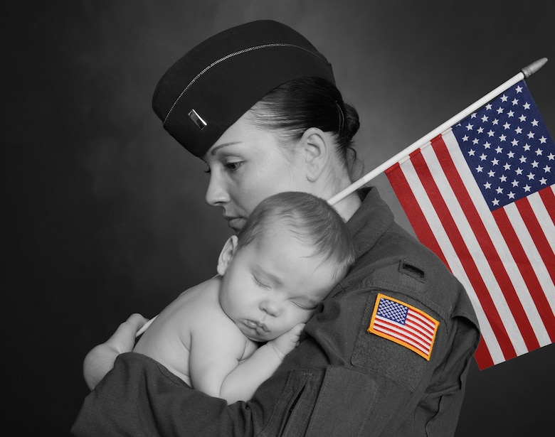 1st Lt. Sheila Koebel, 12th Missile Squadron ICBM operator, poses with son, Lincoln.  By collaborating with other mothers, the process of formalizing a mother's room in the 341st Missile Wing headquarters building began in February. (U.S. Air Force photo illustration/Beau Wade)