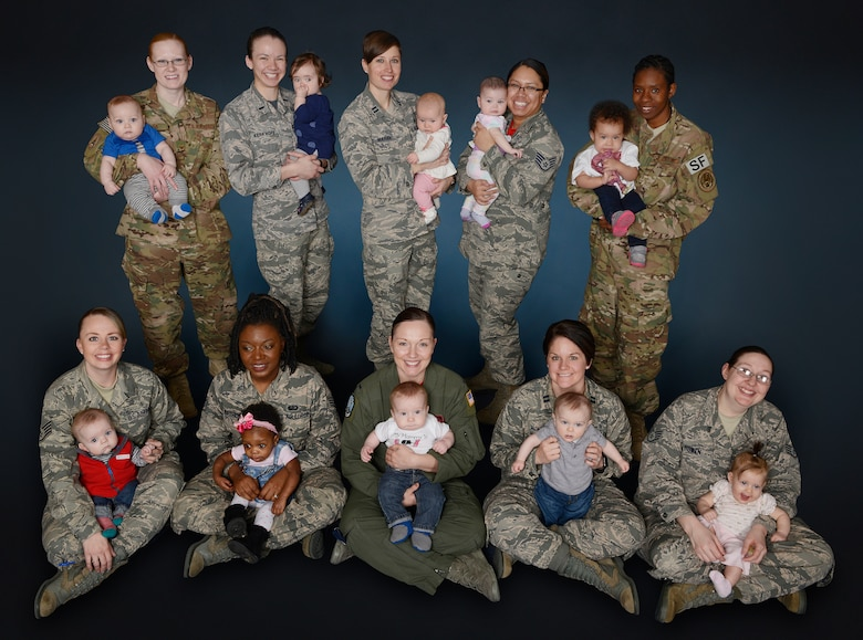 A group of 10 mothers represent a small portion of women serving in the U.S. Air Force while breast-feeding their child.  In recognition of the well documented, evidence-based health advantages of breast-feeding for both infants and mothers, a progressive stance ensures all women have an adequate space to express breast milk and the opportunity to breast-feed. (U.S. Air Force photo/Beau Wade)