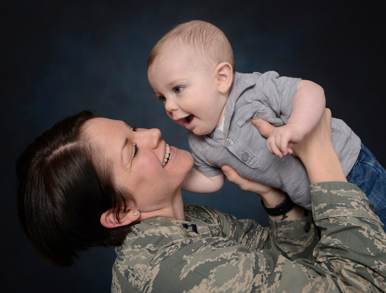 "Capt. Morgan McNabb, 341st Medical Operations Squadron family advocacy officer, poses with son, Dominic. Air Force Instruction 44-102, ""Medical Care Management,"" was revised in 2012 to include a breast-feeding policy recommending arrangement of work schedules that allow 15-30 minute breaks, every three to four hours in an area providing adequate privacy and cleanliness, excluding restrooms. (U.S. Air Force photo/Beau Wade)"