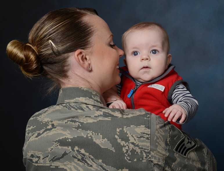 Staff Sgt. Leslie Baccus, 341st Medical Support Squadron, NCO in charge of laboratory shipping, and son, William, pose together. In 2015, women in the Air Force were authorized one year from the birth of a child to be exempt from deployments and return to physical fitness standards.  This year the Pentagon set maternity leave to 12 weeks across the Department of Defense. (U.S. Air Force photo/Staff Sgt. Delia Marchick)