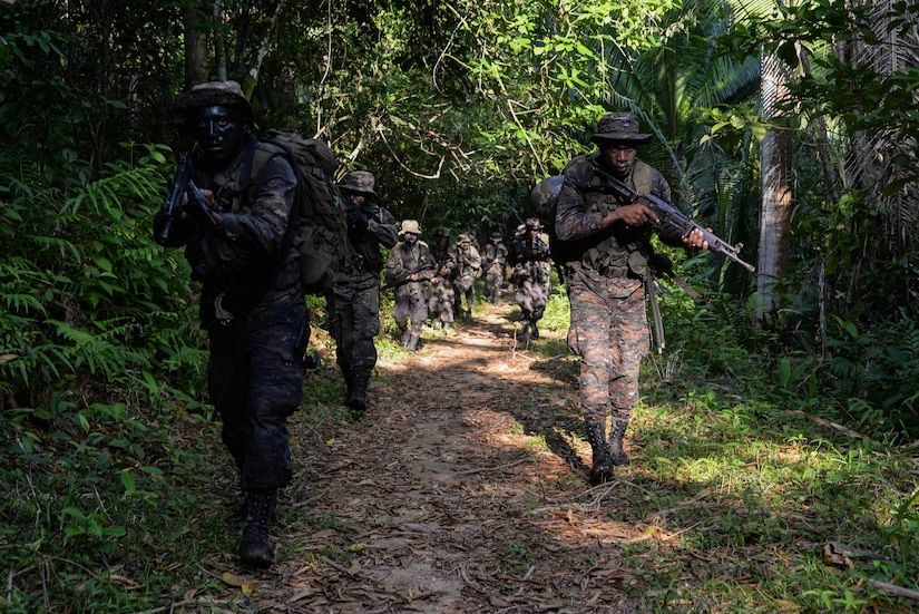 Guatemalan marines participate in a training march, March 9, 2016, Guatemala, as a part of four-week course provided by a U.S. Marine Security Cooperation Team. The Guatemalan marines participated in various physical and planning training activities geared toward urban operations to help them more effectively counter drug trafficking operations in the area. (U.S. Air Force photo by Staff Sgt. Westin Warburton/RELEASED)