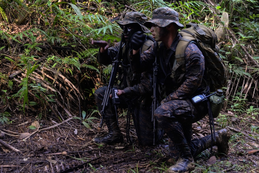 Guatemalan marines navigate to their training target March 9, 2016, Guatemala, during a four-week course meant to hone squad level movements. The Guatemalan marines completed a final exercise before their graduation, partnering with subject matter experts from a U.S. Marine Security Cooperation Team. (U.S. Air Force photo by Staff Sgt. Westin Warburton/RELEASED)
