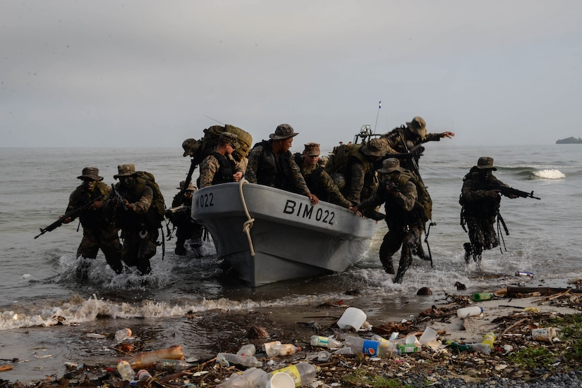 Guatemalan marines conduct water assault training under the supervision of U.S. Marines March 9, 2016, Guatemala, as a part of a U.S. Security Cooperation Team. The Guatemalan marines completed a final exercise before their graduation, testing skills they learned during the four-week training course, which taught them how to more effectively combat drug trafficking criminal organizations. (U.S. Air Force photo by Staff Sgt. Westin Warburton/RELEASED)