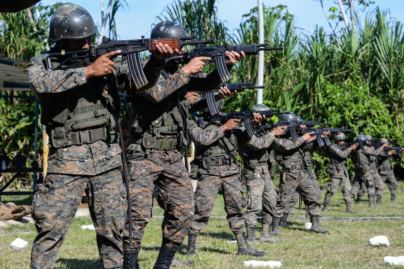 Guatemalan marines practice lining up their sights March 10, 2016, Guatemala, prior to a live-fire exercise. The Guatemalan marines took part in a four week training course to hone their skills in basic infantry movements and urban operations with the intent of helping them combat drug trafficking organizations. (U.S. Air Force photo by Staff Sgt. Westin Warburton/RELEASED)